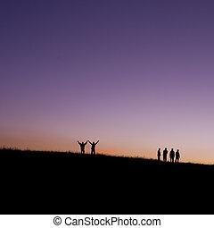 six children jumping for joy on mountain silhouette sunset