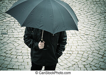 man with umbrella - specia toned and vignetting
