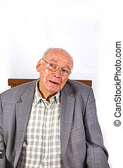 elderly smart confident man sitting in his armchair