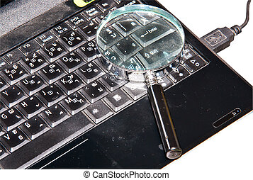 Notebook computer - Magnifying glass put on notebook...