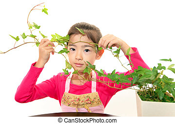 Smiling Asian girl with plant
