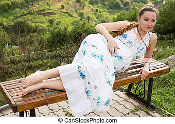 Beautiful pregnant woman with long hair meditating and relax...