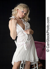 The blonde in a white dress with bare breasts.