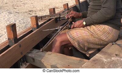 indian worker with primitive drill