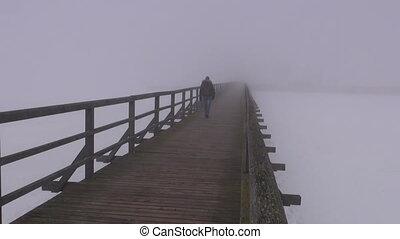 wooden bridge in mist