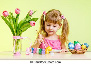 cute kid girl painting Easter eggs