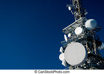 communication tower - A communication tower on deep blue sky...