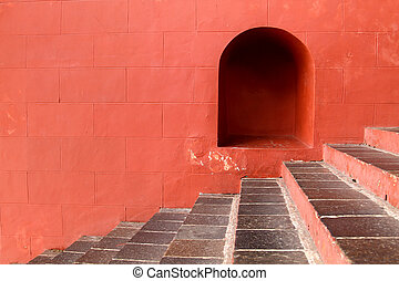 red brick wall with stairs