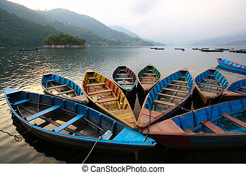 Colorful boats in Phewa lake, Nepal - Colorful boats in...
