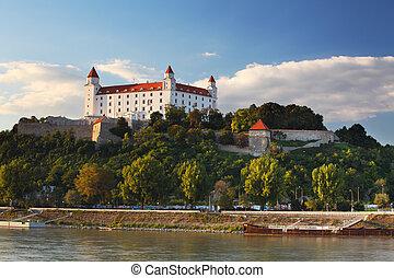 Bratislava castle with reflection in river Danube