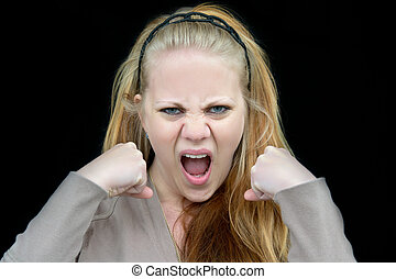 angry woman - woman who looks very angry with clenched fists...