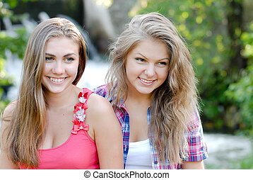 portrait of attractive two best friend having fun - portrait...