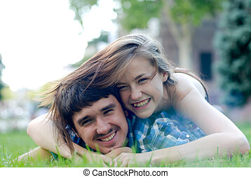 Happy young couple embracing in love - Happy young teenage...