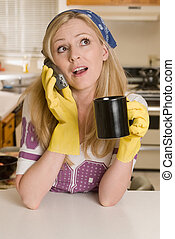 Housewife on the phone - Blond caucasian woman wearing...