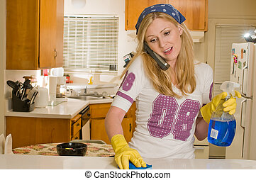 Woman multi tasking - Blond caucasian woman wearing yellow...