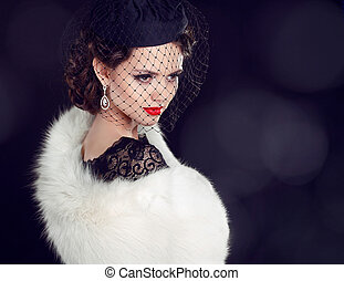 Beautiful woman in fur coat Jewelry and Beauty Fashion photo...