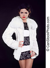 Winter Girl in Luxury Fur Coat, Fashion lady isolated on black background