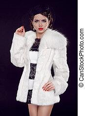 Beautiful woman in fur coat. Jewelry and Beauty. Fashion photo