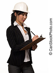 Business woman in hard hat - Asian woman in business suit...