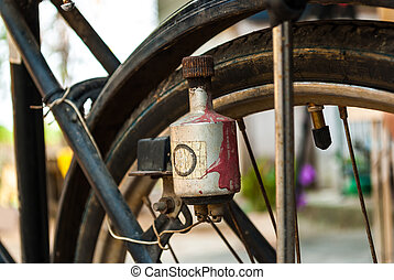 Electric generator dynamo on antique bicycle - In the past...