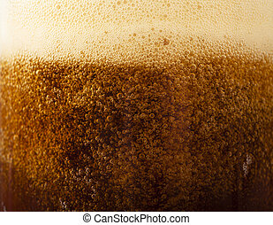 Beer background - Closeup view of dark beer pouring into the...