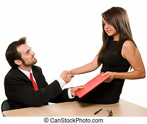 Business deal - Attractive brunette woman sitting on a desk...
