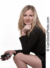 Business woman sitting - Attractive blond woman wearing...