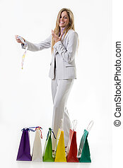Overspending - Attractive blond woman wearing grey business...