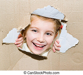 kid in torn paper hole - smily kid portrait in torn paper...