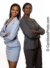 Business partners - Two African American business women with...