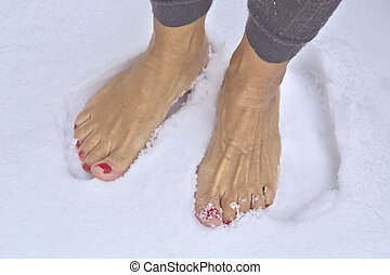 Barefoot woman - Woman standing barefoot in fresh snow