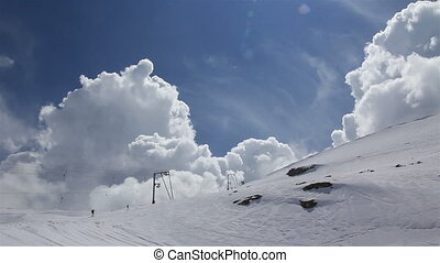Clouds Ski - Large clouds over ski resort Some people on...