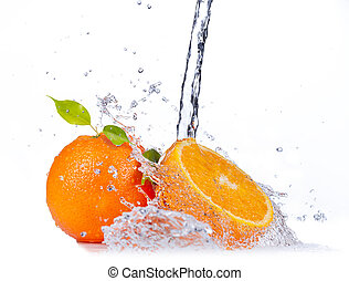 Fresh oranges with water splash, isolated on white...