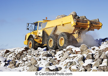 trucking in rough snowy terrain - heavy truck driving in...