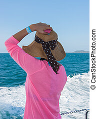 Woman  in a hat looking at sea