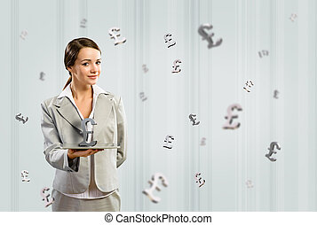 business woman holding a tablet with british pound -...