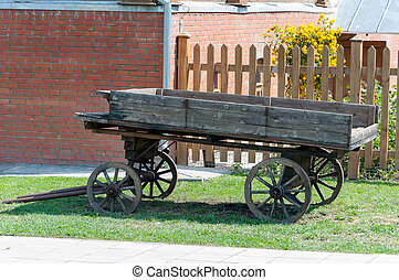 old wagon - Old wooden wagon on grass