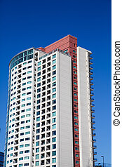 White and Red Condo Tower on Clear Blue Sky