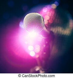 microphone on stage with purple shiny glare
