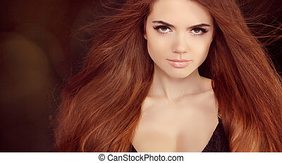Beautiful woman with long brown hair. Closeup portrait of a...