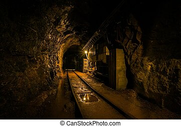 Underground mine passage with rails and light