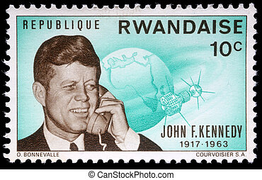 John Fitzgerald Kennedy - A stamp printed by Rwanda, shows...