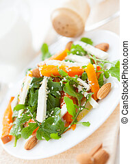 slices of pumpkin and feta on a white plate, food closeup