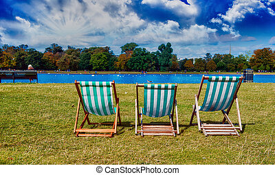 Relaxing on deckchair in a beautiful park
