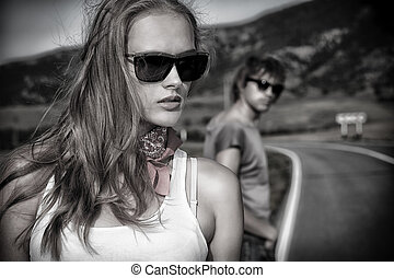sentiment - Couple of modern young people posing on a road...