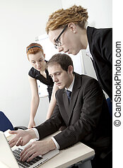 Business team brainstorming - Three members of a business...
