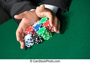 Gambler stakes quot;all inquot; pushing his chips forward -...