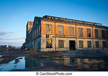 Abandoned plant - Abandoned industrial plant at sunset,...