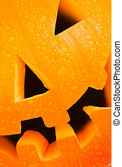 Halloween lantern closeup - Pumpkin head closeup and cropped...