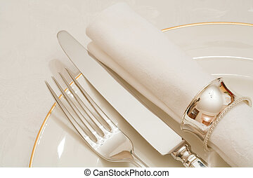 Catering - Place setting with cutlery, plate and napkin on a...